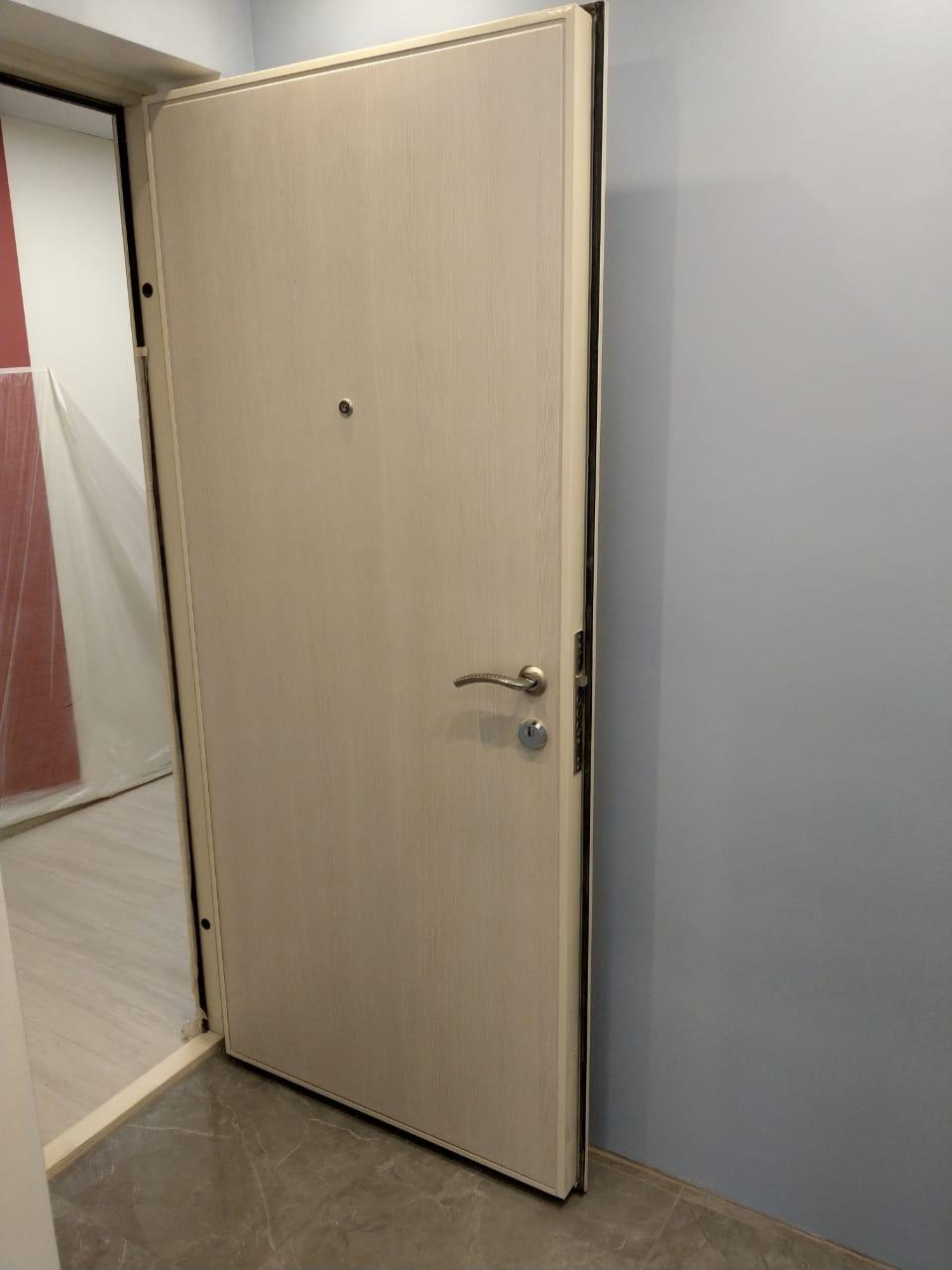 Замена дверной накладки металлической двери в Самаре